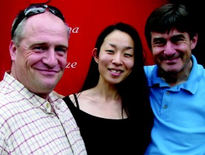 Len Clarke and Shiho Watanabe of Racenow with Nissan's Gareth Rees