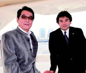 Ceremony president Sucasa Shiga and Oscar-winning Japanese director Yokiro Takita on Shiga's yacht.