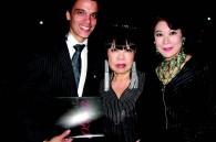 Tango dancers Juan Guida and Yu Kozaka with fashion designer Junko Koshino
