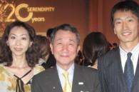 Mariko Takeda and Mao Mihashi of Ryokan Monthly magazine flank Imperial Hotel president Tetsuya Kobayashi