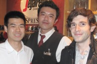 Segafredo staff members Tabito Morito and Hiroyuki Komatsu with Thomas Iljic of the French embassy