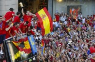 Spain return home to heroes welcome
