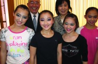 Min-On Concert Association president Hiroyasu Kobayashi, director of Beijing's central exchange department Wang Xio Yun, and members of the acrobatic team