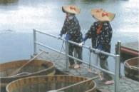 Fisherwomen and their taraibune around at harbor