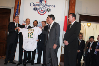 US Ambassador John V. Roos receives his personalized jersey