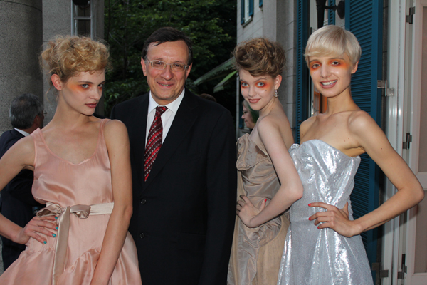 David Warren, the British ambassador, and three Vivienne Westwood models
