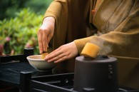 Japanese Woman Performing Tea Ceremony