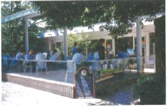 Al fresco dining between parks at Cafe des Aristes