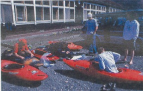 Preparing kayaks at HOA base