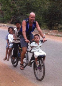 Jamie putting smiles on the faces of orphan kids in Cambodia