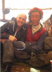 Jamie hanging a with high altitude yak herder after warming up with some yak butter tea
