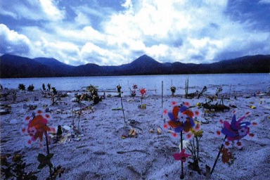 The shore of the crater lake is blanketed with offerings