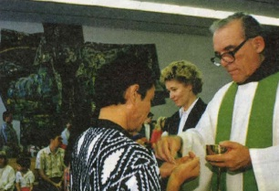 Father William distributes Communion