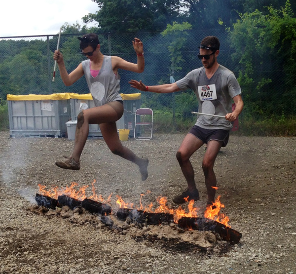 Sarah Custen and Chad Miles negotiate part of the Yakitori obstacle