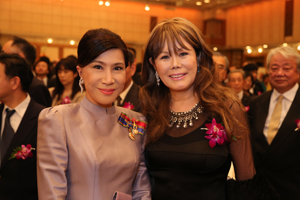 At the Thai King's Birthday Celebration: Hostess Monthip Upatising and TV personality Kyoko Spector
