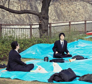 "Taka and Koji are higher up in rank than these two fellows, who would have been sent by their bosses to snag good spots ahead of time (Photo: ""Hanami Salarymen"" by Janne Moren/Flickr)"