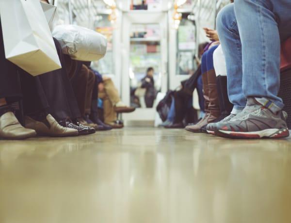 Passengers feet in subway car