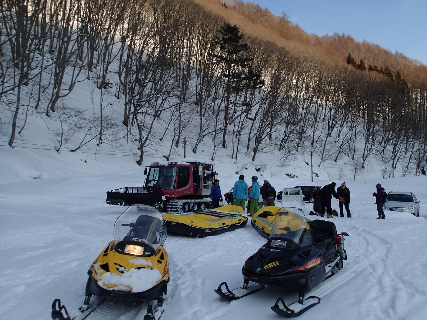 Snowmobiles and rafts. Photo by Phil Luza