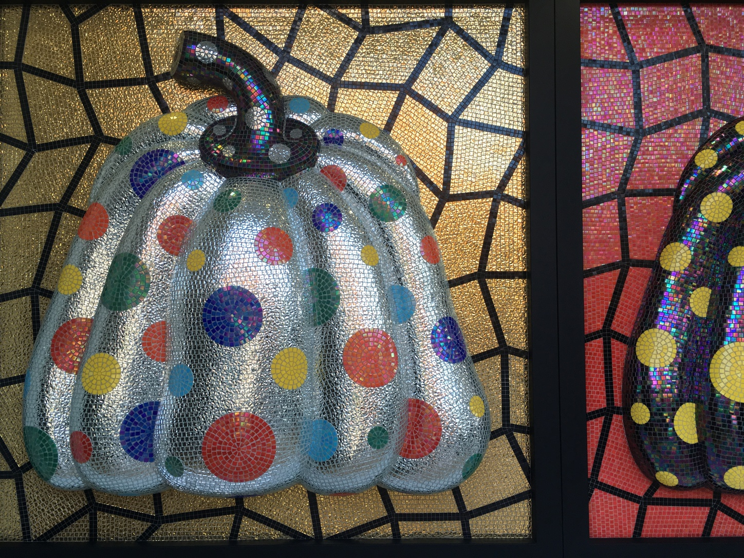 Kusama's famed pumpkin paintings and sculptures make an appearance
