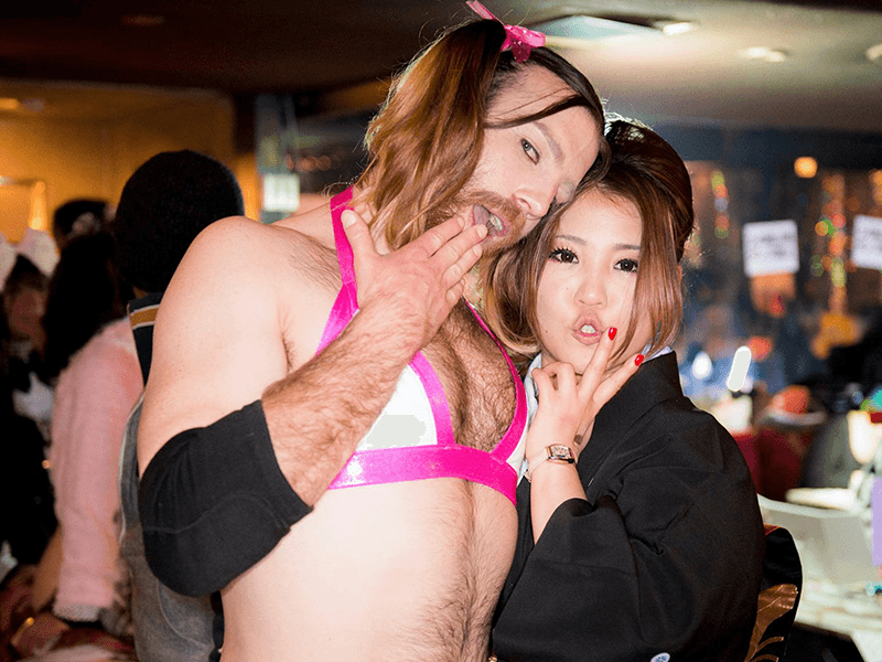 ladybeard posing with one of his fans