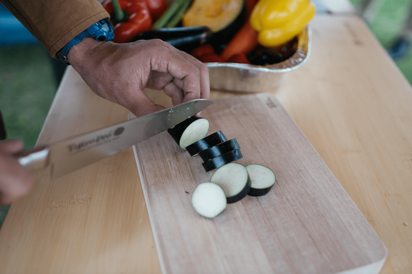 knife cutting vegetables on wooden chopping board in niigata