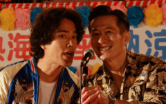 still from the movie hibana showing two comedians standing in front of the microphone