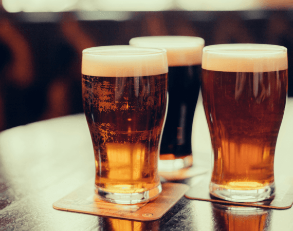three glasses of beer at a pub