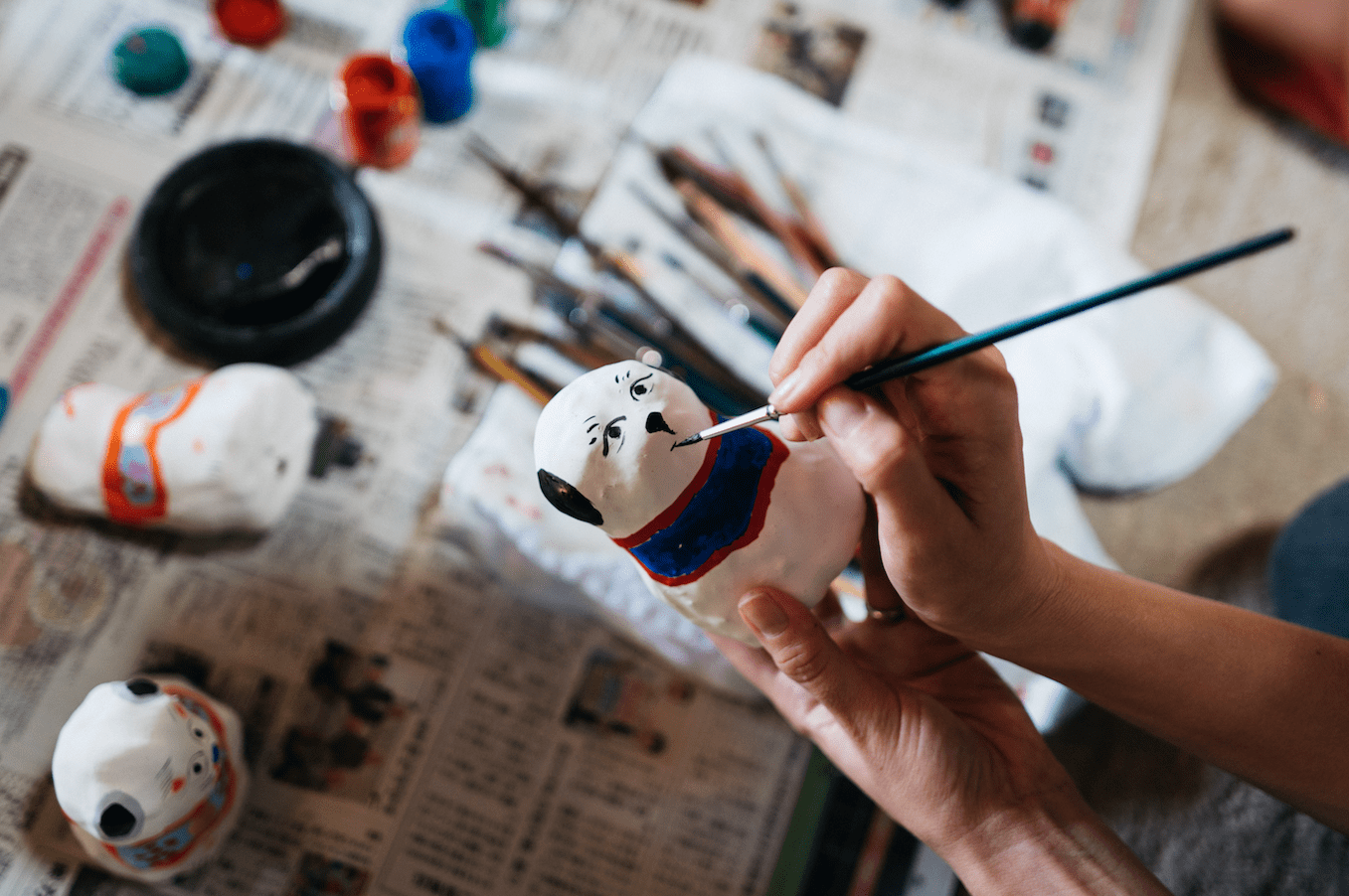 Painting a hariko doll