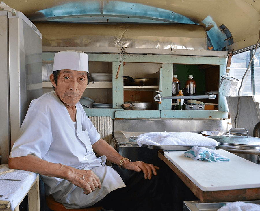 a man from tohoku sitting in a kitchen