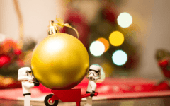 lego stormtroopers moving a Christmas ornament