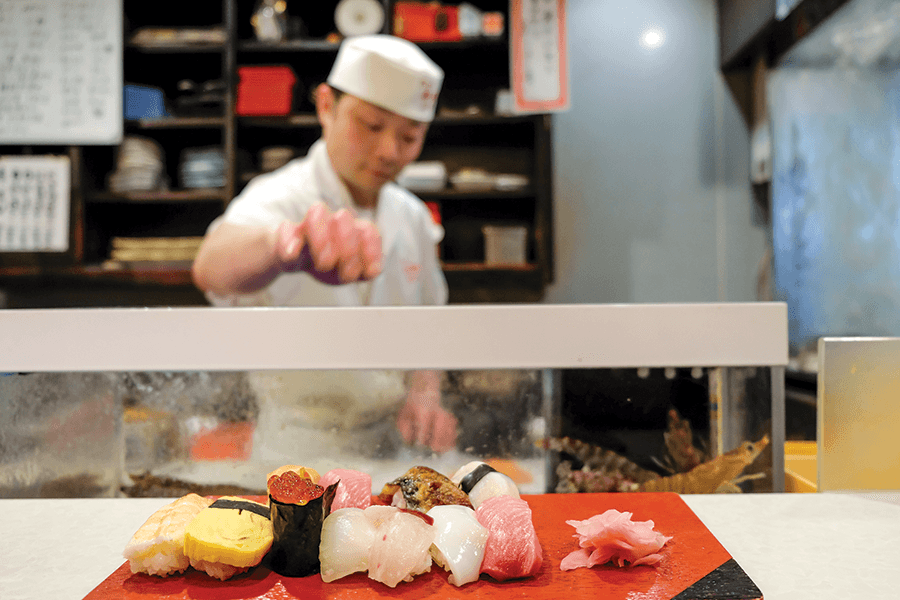 sushi chef at a sushi counter