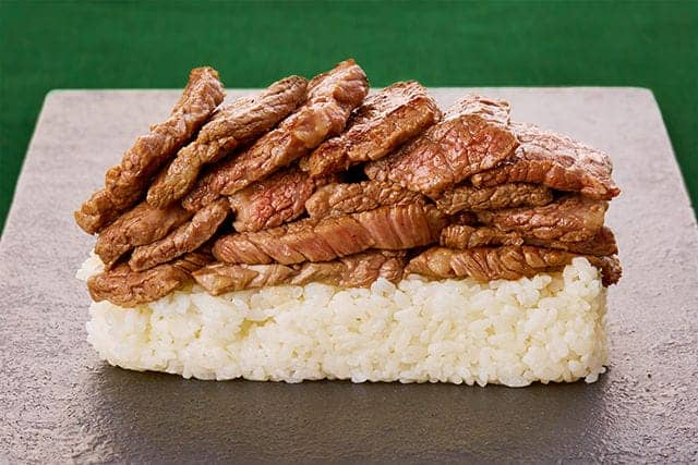 lots of beef piled high on rice