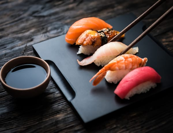 a dish with pieces of sushi