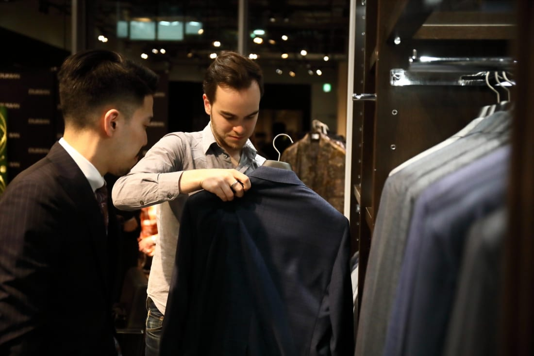 Customer looks at D'URBAN men's suits