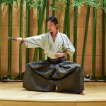 Swordsman brandishes samurai sword at The Japanese Sword Museum