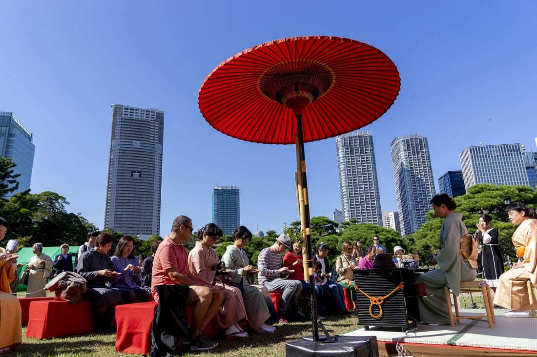 Foreign visitors participate at outdoor tea ceremony at Hamarikyu Gardens