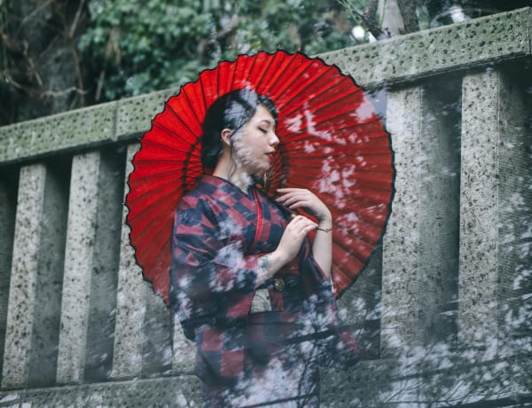 A woman in kimono holding parasol in Tokyo